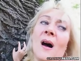 Buxomy Mature Receives Facial Outdoor