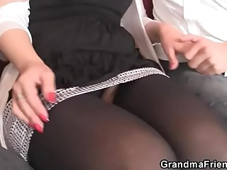 Mature babe in stockings swallows two cocks