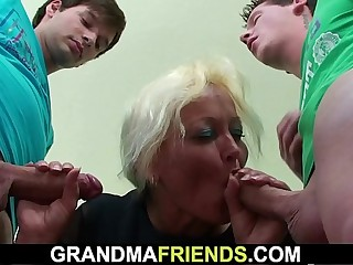 Threesome with old teacher in the classroom