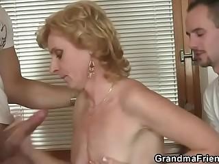 Mature slut takes two cocks