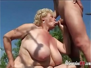 Chubby Granny Blonde With Huge Tits And Her Young Lover Screw Outdoor