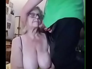 Granny with big boobs takes junior cock
