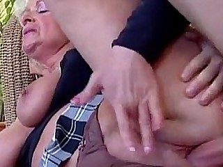 Big-titted mature loves young cock