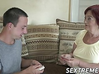 Busty redhead granny rides a youthful guy