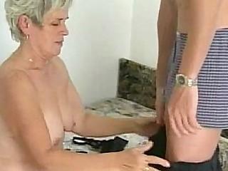 Hairy granny tastes youthful cock