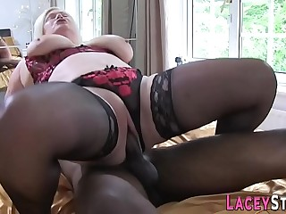 Granny gobbles big black cock and gets poked