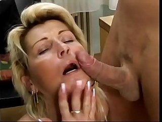 Scorching blonde granny takes young cock in her hairy twat