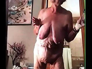 Saggy granny uses a egg sex toy.