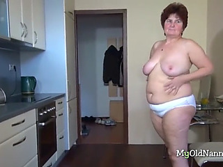 Plump granny bonks herself with a toy