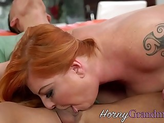 Redheaded granny blowing