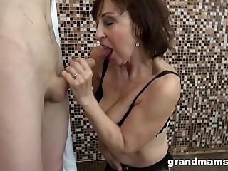 Horny granny fucks step nephew in the shower