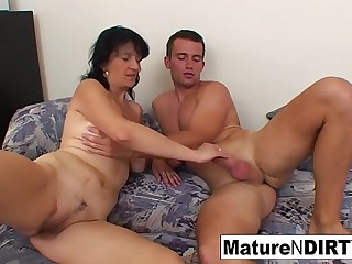 Busty grandma takes a load on her tits